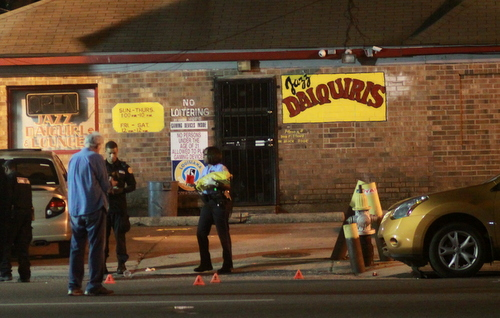 Police lay out evidence cones near the parking lot of the Jazz Daiquiri on South Claiborne Avenue. (Robert Morris, UptownMessenger.com)