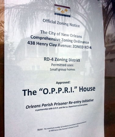 A sign at the Uptowner alerting neighbors of a proposed prisoner re-entry program. (Robert Morris, UptownMessenger.com)