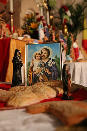 Saint Joseph picture among statues and more decorative bread created by NOCCA students. (Zach Brien, UptownMessenger.com)