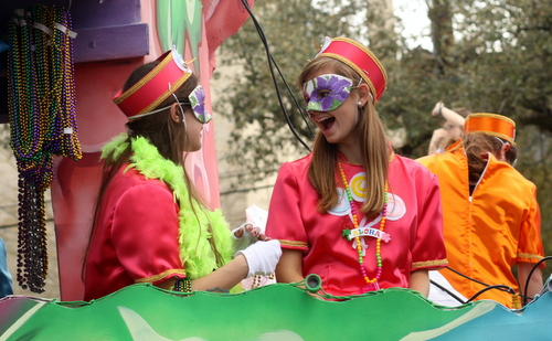 "Riders on the Iris ""Rock Candy"" float laugh together. (Robert Morris, UptownMessenger.com)"