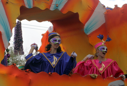 "Riders on the Krewe of Iris ""Rock of Ages"" float throw to the Napoleon Avenue crowds. (Robert Morris, UptownMessenger.com)"