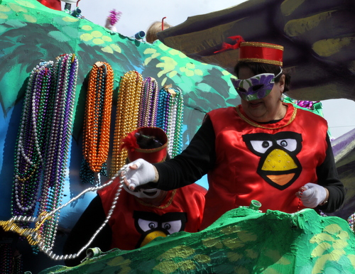"The Angry Birds video game characters make their way onto the Iris ""Rockin Robin"" float riders' costumes. (Robert Morris, UptownMessenger.com)"