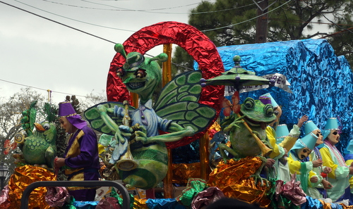 "The Krewe of Mid-City's ""Green Hornet"" float rolls on Magazine Street. (Robert Morris, UptownMessenger.com)"