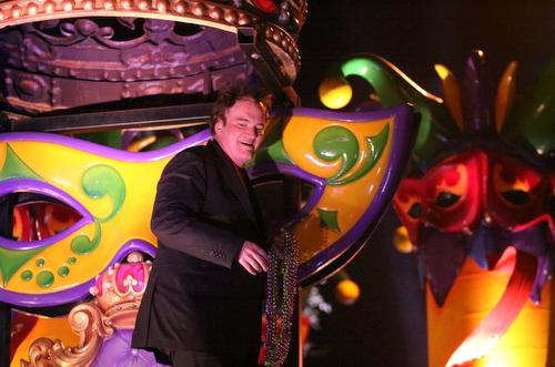 Quentin Tarantino rides in the Krewe of Orpheus. (UptownMessenger.com)