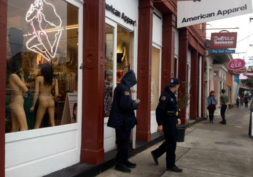 Police outside of American Apparel on Magazine Street after an armed robbery occurred (Della Hasselle, MidCityMessenger.com).