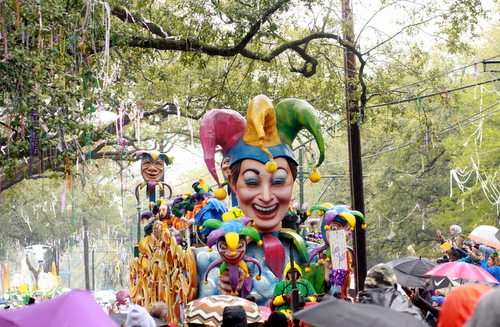 "The Rex ""Jesters"" float rolls through the rain on St. Charles Avenue. (Robert Morris, UptownMessenger.com)"