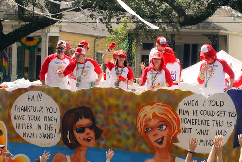 "Riders toss beads from the Krewe of Tucks ""Bat 'Er Up"" float, featuring the double entendres throughout their ""Sporting Life"" theme. (Robert Morris, UptownMessenger.com)"