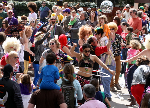 The Disco Amigos dance under a disco ball in the Krewe of Tucks parade. (Robert Morris, UptownMessenger.com)