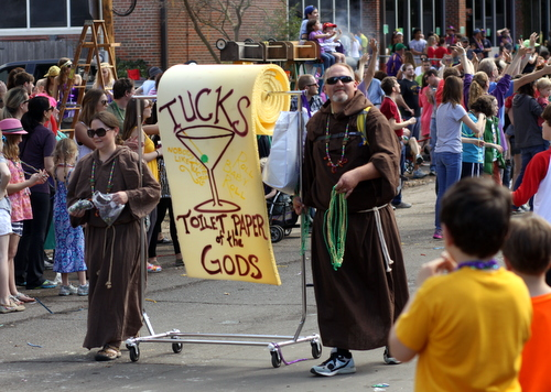 The Krewe of Tucks holds their tradition of throwing toilet paper in high esteem. (Robert Morris, UptownMessenger.com)