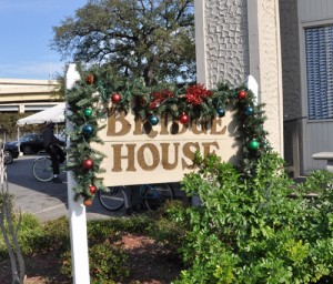 The Bridge House sign at Grace House decorated during the winter holidays. (UptownMessenger.com file photo by Marta Jewson)