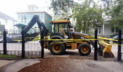 At least two sections of the Newcomb Boulevard fence have been removed as of Tuesday morning. (Robert Morris, UptownMessenger.com)
