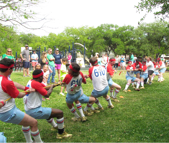 610 Stompers compete in a game of tug-of-war at ROMP! 2013 (via habitat-nola.org)
