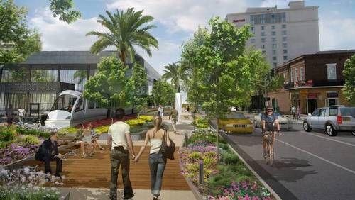 A view of the proposed Convention Center Boulevard linear park and people mover. (via mccno.com)