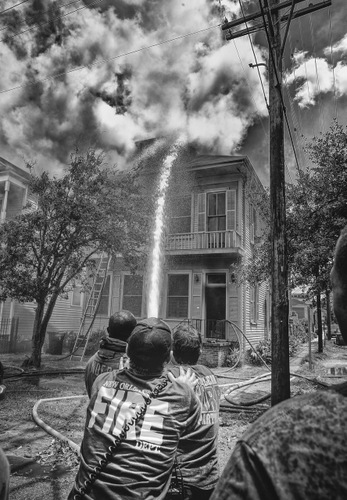 Firefighters battle a blaze on Camp Street on Monday afternoon. (photo courtesy of Bob Perrin)