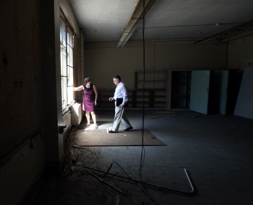Marina Schoen and Keith Bartlett of Lycee Francais look out a second-story classroom window at Priestley. (Robert Morris, UptownMessenger.com)