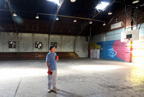Jim McPhaille of Lycee Francais takes a look at the Priestley gym. (Robert Morris, UptownMessenger.com)