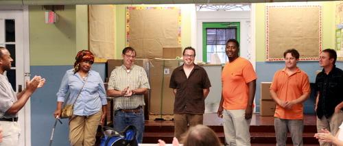 From far left, Freret Neighbors United board members Andrew Amacker, Linda Compton and Richard Dimitry, secretary Scott Solo, president Stan Norwood, vice president Michael Collins and board member Matt. (Robert Morris, UptownMessenger.com)