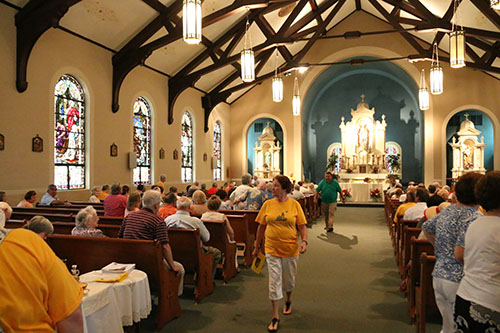 The Feast of St. Henry mass took place at 3 pm right before the block party. (Zach Brien, UptownMessenger.com)