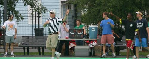 Kara Morgan (center) runs a scoreboard and timer powered by an extension cord from the home next door during makeshift neighborhood basketball tournaments in the Irish Channel. (submitted photo)