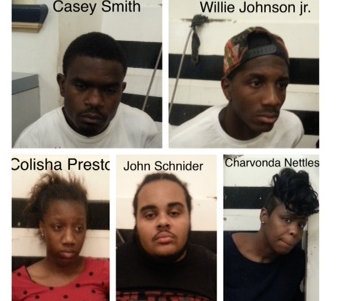 Five suspects charged with driving around the Central Business District and shooting four homeless people with pellet guns. (images via NOPD)