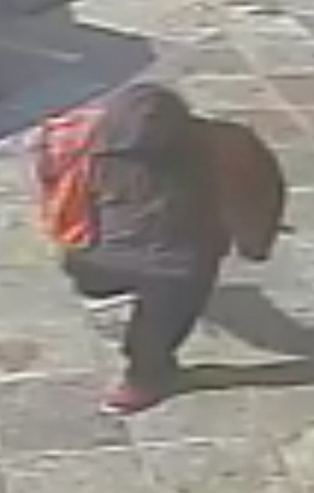 A still image of the suspect outside the business. (via NOPD)
