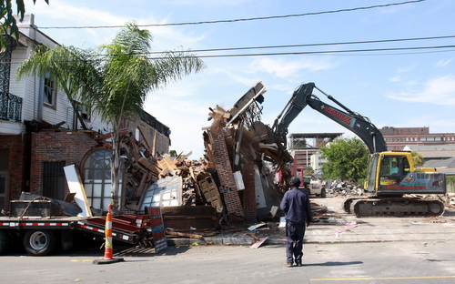Demolition workers push over a wall of the former Frank's Steakhouse on Freret Street on Wednesday. (Robert Morris, UptownMessenger.com)