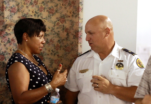 New Sixth District Commander Ronnie Stevens (right) speaks to Central City resident Lisa Martin at a reception on Wednesday. (Robert Morris, UptownMessenger.com)