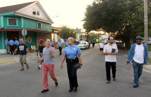 Detective Anya Hilliard talks to Delachaise Neighborhood Association member Will Winebrenner as they walk down Dryades Street on Wednesday evening. (Robert Morris, UptownMessenger.com)