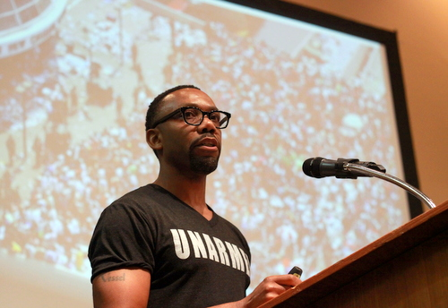 Dr. Andre Perry delivers the keynote address at the Rising Tide conference Saturday, Sept. 13. (Robert Morris, UptownMessenger.com)