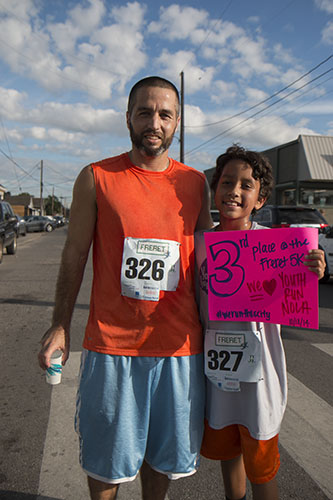 Father and son duo, DJ and Caden Lewis, ran Saturday's 5K together. (Zach Brien, UptownMessenger.com)
