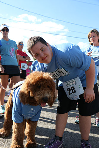 Alex Boudreaux poses with Maddox, a golden doodle with his own instagram following. (@NOLAdoodles) This was Alex Boudreaux's first 5K run/walk. (Zach Brien, UptownMessenger.com)