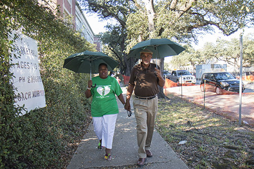 Joann and Noel Bradley walk hand-in-hand down Napoleon avenue Saturday afternoon as part of Helping Mothers Heal conference. (Zach Brien, UptownMessenger.com)