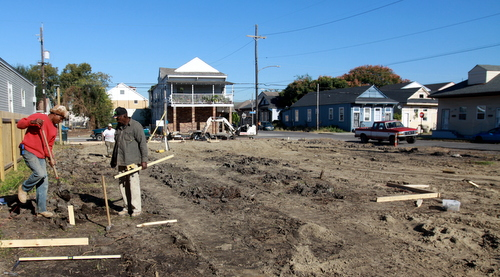 Workers from Cutting Edge Renovations prepare the vacant lot at Saratoga and Foucher on Wednesday, Nov. 20, for the construction of two new houses by Pentek Homes. (Robert Morris, UptownMessenger.com)