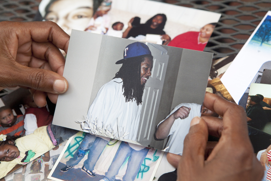 """""""That big beautiful smile,"""" said Dimes as she holds a picture of her son Danny. (Sabree Hill, UptownMessenger.com)"""
