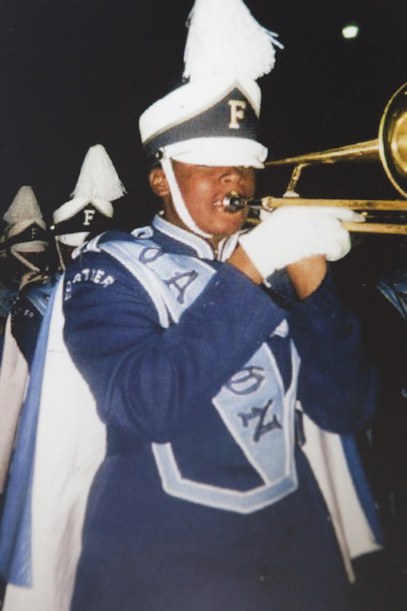 Chris playing trombone at Forshey High School.