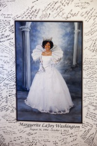 A photograph of LaJoy as the reigning Queen of The New Orleans Chapter of Delta Sigma Theta Sorority, was signed by hundreds at her funeral. (Sabree Hill, UptownMessenger.com)