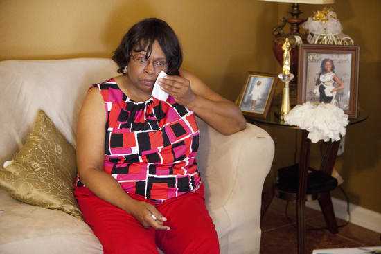 "Margaret Washington wipes a tear from her eye as she speaks about the death of her daughter LaJoy. ""I need some closure with a conviction. Closure doesn't mean the end,"" said Washington. (Sabree Hill, UptownMessenger.com)"