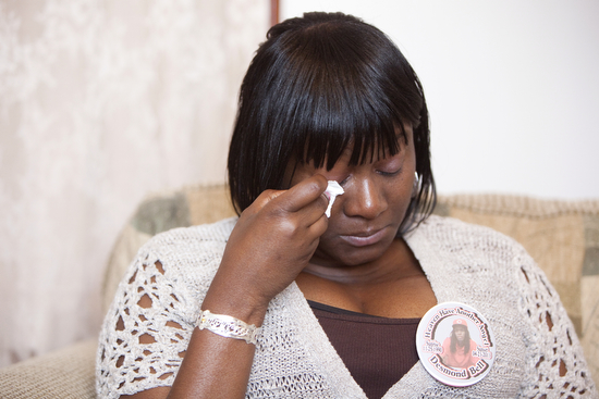 "Martha Bullock wipes a tear from her eye as she talks about her son Desmond. ""It's just the beginning. When we have a tiral, if we ever have one, we will have to live this all over again and start the healing process all over again,"" said Bullock."
