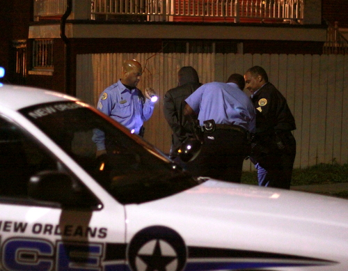 New Orleans police officers take a suspect into custody at the corner of Cadiz and Loyola streets during a two-hour manhunt in the area Sunday evening following a rash of Uptown robberies. (Robert Morris, UptownMessenger.com)