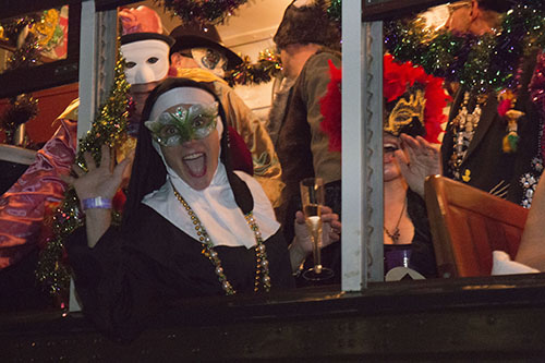 Masks on and drinks in hand, the Phellows packed the streetcar as it headed down St. Charles. (Zach Brien, UptownMessenger.com)