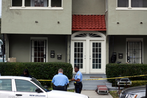 Stretchers await the bodies of two Tulane Law students killed in a murder-suicide on Willow Street on Sunday morning. (Robert Morris, UptownMessenger.com)