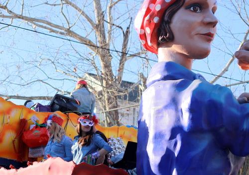 "Riders strike a pose on the Krewe of Alla ""Women at War"" float on Magazine Street. (Robert Morris, UptownMessenger.com)"
