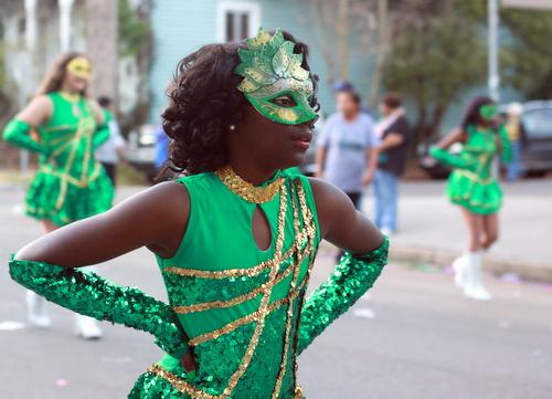 A dancer from Samuel J. Green Charter School marches in the Mystic Krewe of Femme Fatales parade. (Robert Morris, UptownMessenger.com)