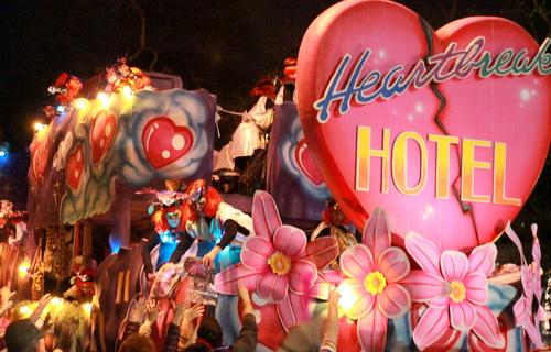 "Riders distribute purses from he Nyx ""Heartbreak Hotel"" float. (Robert Morris, UptownMessenger.com)"