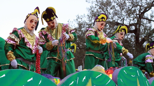 Riders in the Knights of Babylon parade atop the Jesters float. (Robert Morris, UptownMessenger.com)