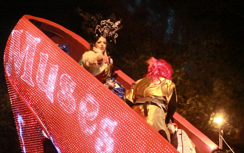 Honorary Muse Sue Zemanick rides in the krewe's signature shoe float. (Robert Morris, UptownMessenger.com)