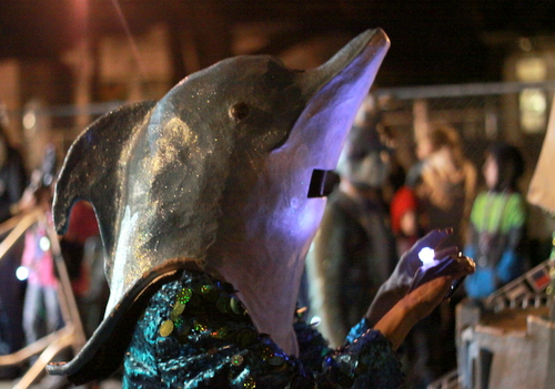 A Krewe of Kolossos dolphin takes a selfie during the Muses parade. (Robert Morris, UptownMessenger.com)