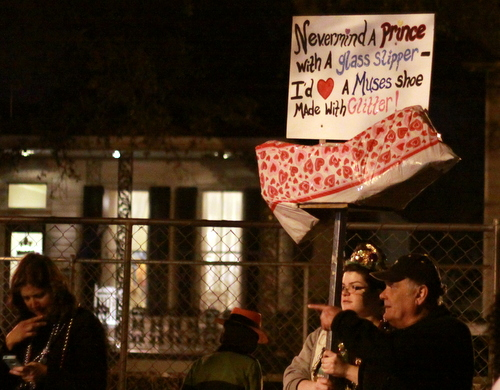 Parade-goers used elaborate signs to beseech the Muses for shoes. (Robert Morris, UptownMessenger.com)
