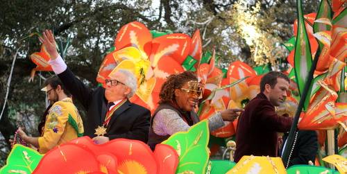 The cast of NCIS: New Orleans interacts with the crowd as they ride in the Krewe of Orpheus. (Robert Morris, UptownMessenger.com)