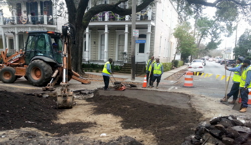 Workers patch up a section of Magazine Street on Friday afternoon after digging it up to find a sewer leak that shut down the street. (Robert Morris, UptownMessenger.com)